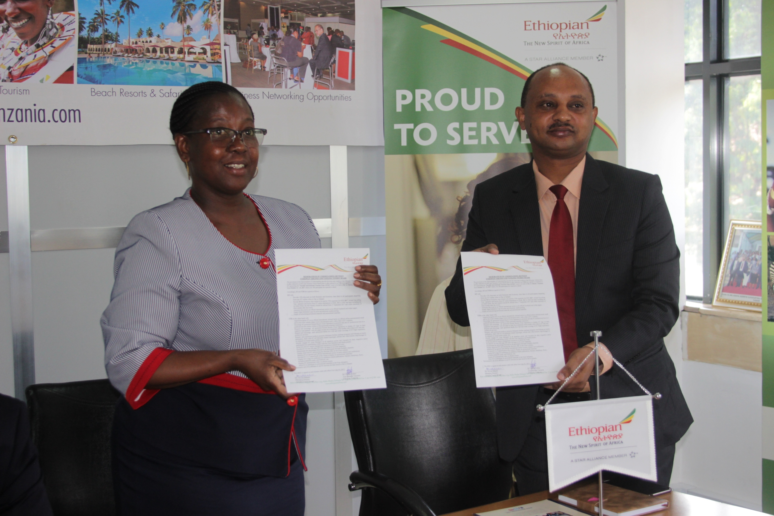 The TTB Managing Director, Ms Devota Mdachi (left) and Ethiopian Airlines Resident Manager, Mr Dahlak Teferi (right), display copies of the cooperation protocol they signed on August 21, 2017 in Dar es Salaam.  The two institutions pledged to organise successfully the coming SITE 2017 to be stated at Julius Nyerere International Convention Centre in Dar es Salaam. (Picture by Staff Photographer Isdory Njavike)